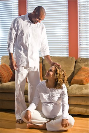 pregnant couple couch - Pregnant woman sitting on floor next to standing man touching her head Stock Photo - Rights-Managed, Code: 842-02753765