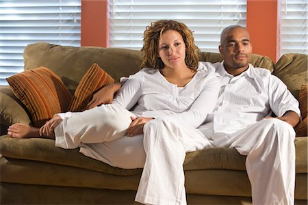 pregnant couple couch - Portrait of African American couple sitting on sofa in living room Stock Photo - Rights-Managed, Code: 842-02753763