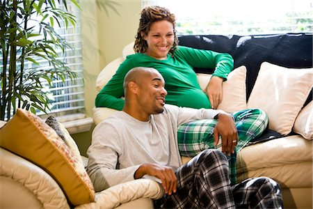 pregnant couple couch - Portrait of African American couple sitting on sofa in living room Stock Photo - Rights-Managed, Code: 842-02753795