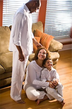 pregnant couple couch - Pregnant woman sitting on floor with boy next to standing man touching her head Stock Photo - Rights-Managed, Code: 842-02753805