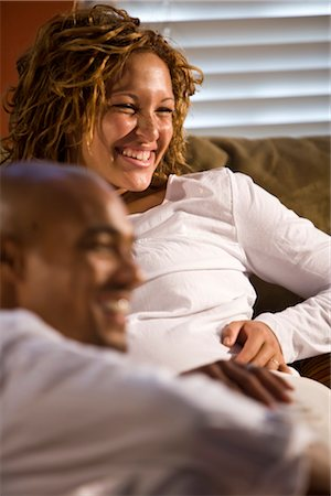 pregnant couple couch - Portrait of African American couple sitting on sofa Stock Photo - Rights-Managed, Code: 842-02753803