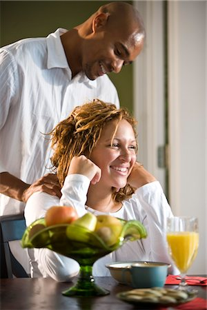 African American man massaging woman's shoulders Stock Photo - Rights-Managed, Code: 842-02753817