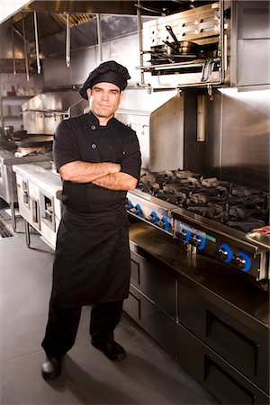Portrait of Cuban chef standing in restaurant kitchen Stock Photo - Rights-Managed, Code: 842-03198515