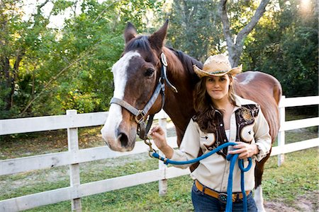 Portrait of young cowgirl with brown Mare horse on farm Stock Photo - Rights-Managed, Code: 842-03198548