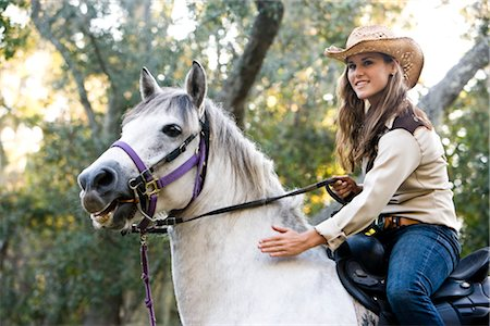 Portrait of young cowgirl riding white Gelding horse Stock Photo - Rights-Managed, Code: 842-03198564