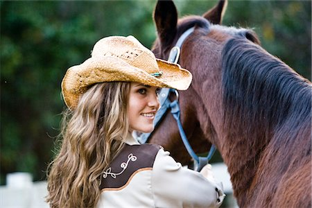 Portrait of young cowgirl with brown Mare horse on farm Stock Photo - Rights-Managed, Code: 842-03198572