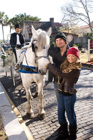 Portrait of young couple standing with horse drawn carriage Stock Photo - Rights-Managed, Code: 842-03198848