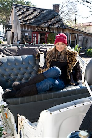 Young woman in warm clothes sitting in horse drawn carriage Stock Photo - Rights-Managed, Code: 842-03198849