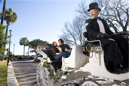 Young couple riding in horse-drawn carriage Stock Photo - Rights-Managed, Code: 842-03198853