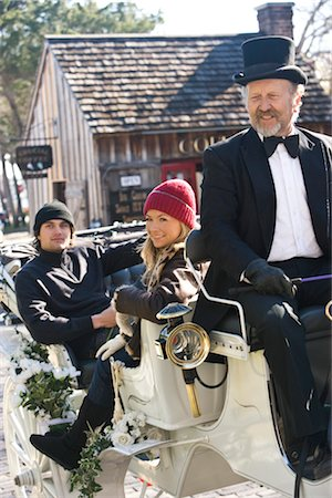 Young couple in warm clothing sitting in horse-drawn carriage Stock Photo - Rights-Managed, Code: 842-03198880