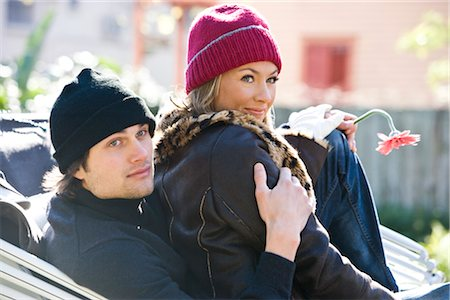 Young couple in warm clothing sitting in horse-drawn carriage Stock Photo - Rights-Managed, Code: 842-03198881