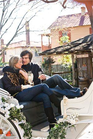 Young couple in warm clothing sitting in horse-drawn carriage Stock Photo - Rights-Managed, Code: 842-03198882