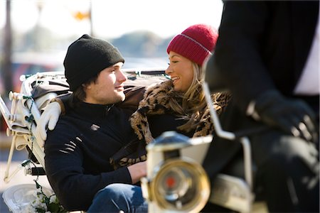 Young stylish couple sitting in horse drawn carriage Stock Photo - Rights-Managed, Code: 842-03198898
