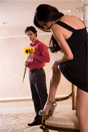 sexy women legs - Romantic sexy young couple holding sunflowers Stock Photo - Rights-Managed, Code: 842-03199158