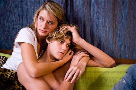 sad girls - Young affectionate teenage couple sitting on sofa indoors Stock Photo - Rights-Managed, Code: 842-03199276