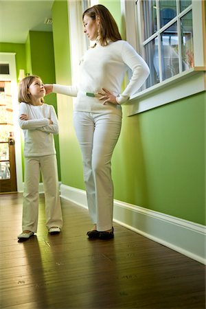 sad girls - Mother and daughter standing in hallway of home Stock Photo - Rights-Managed, Code: 842-03199398
