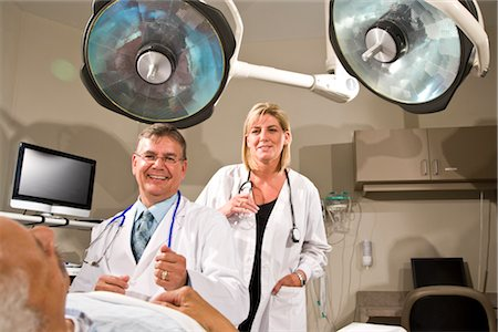 Doctors with patient in hospital room Stock Photo - Rights-Managed, Code: 842-03199654