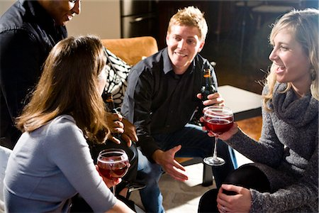 Multi-ethnic couples having drinks together in living room Stock Photo - Rights-Managed, Code: 842-03199988
