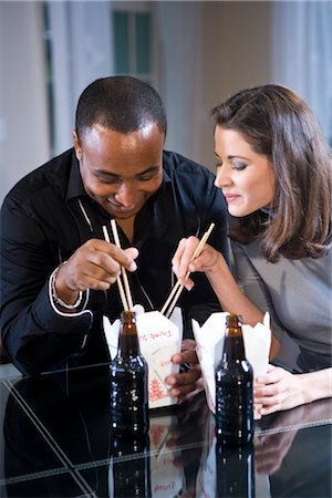 Interracial couple eating Chinese take-out at home Stock Photo - Rights-Managed, Code: 842-03200004