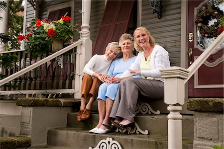 Elderly woman and adult daughters on front porch of house Stock Photo - Rights-Managed, Code: 842-03200058