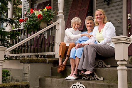 Elderly woman and adult daughters on front porch of house Stock Photo - Rights-Managed, Code: 842-03200059