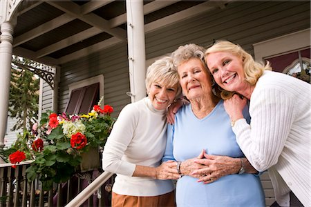 Elderly woman with adult daughters outside house Stock Photo - Rights-Managed, Code: 842-03200062