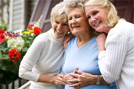 Elderly woman and adult daughters on front porch of house Stock Photo - Rights-Managed, Code: 842-03200096