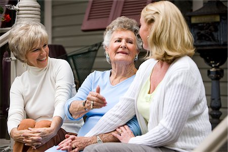 Elderly woman and adult daughters on front porch of house Stock Photo - Rights-Managed, Code: 842-03200091