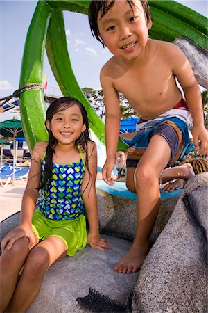 Two Asian children on at water park in summer Stock Photo - Rights-Managed, Code: 842-03200233