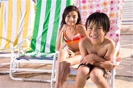 Multi-ethnic children sitting on pool deck Stock Photo - Rights-Managed, Code: 842-03200257