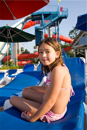 Young girl in swimsuit sitting on deck chair at water park Stock Photo - Rights-Managed, Code: 842-03200277