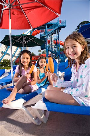 Three young girls at water park eating corn dogs Stock Photo - Rights-Managed, Code: 842-03200282