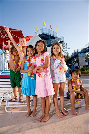 Multi-ethnic children at water park in summer wearing flower leis Stock Photo - Rights-Managed, Code: 842-03200293
