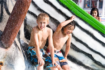 Two boys getting wet at water park in summer Stock Photo - Rights-Managed, Code: 842-03200301