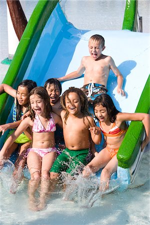 Group of children sliding down waterslide together Stock Photo - Rights-Managed, Code: 842-03200312