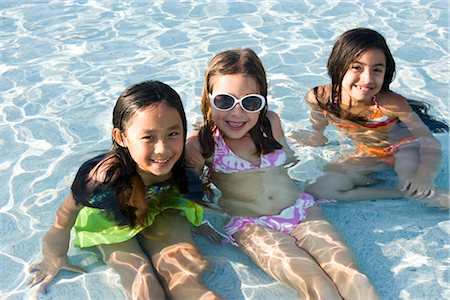 Three young girls in swimming pool Stock Photo - Rights-Managed, Code: 842-03200329