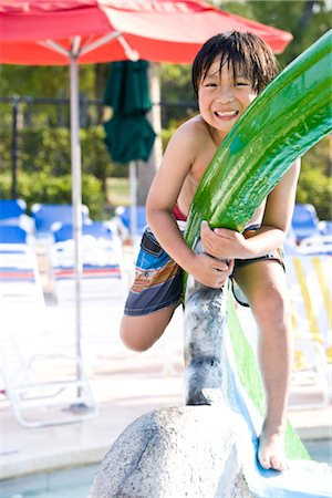 Young Asian boy playing at water park in summer Stock Photo - Rights-Managed, Code: 842-03200322