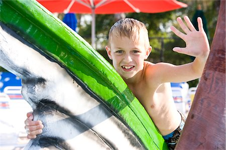 Young blonde boy waving at water park in summer Stock Photo - Rights-Managed, Code: 842-03200323