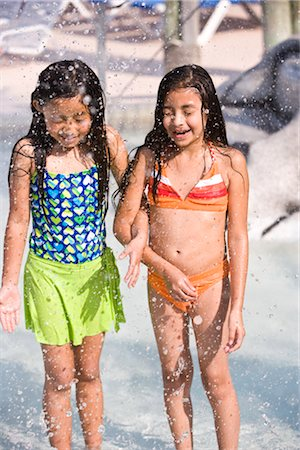 Two young girls arm in arm at water park Stock Photo - Rights-Managed, Code: 842-03200347