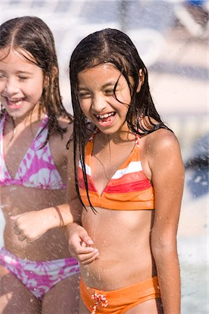 Two young girls arm in arm at water park Stock Photo - Rights-Managed, Code: 842-03200351