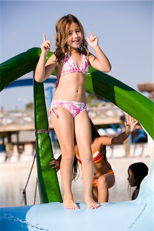 Little girl standing on top of water slide dancing Stock Photo - Rights-Managed, Code: 842-03200369