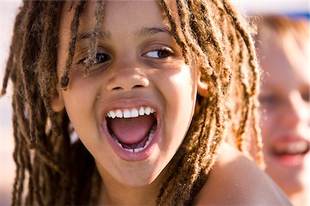 Close-up of happy young African American boy grinning on pool deck Stock Photo - Rights-Managed, Code: 842-03200373