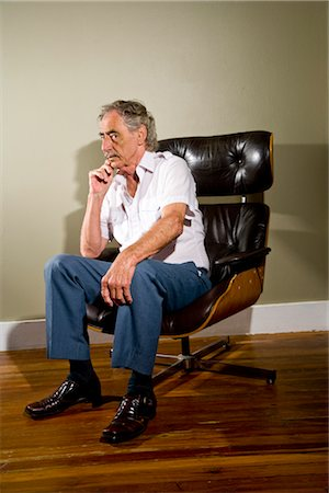 Senior man sitting in chair Stock Photo - Rights-Managed, Code: 842-03200619