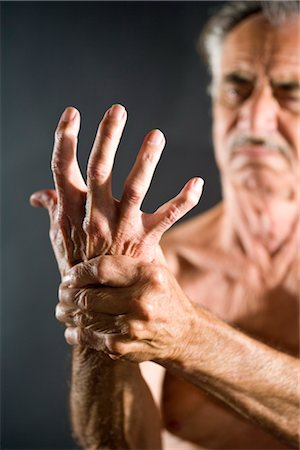 shirtless men - Old man with arthritis pain in hand, studio shot Stock Photo - Rights-Managed, Code: 842-03200656