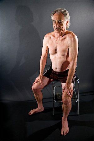 shirtless men - Man senior man sitting on stool against gray background, studio shot Stock Photo - Rights-Managed, Code: 842-03200652