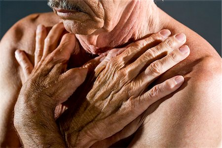 Close-up of shirtless senior man with hands on chest, studio shot Stock Photo - Rights-Managed, Code: 842-03200653