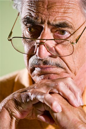 Close-up of serious senior man in eyeglasses Stock Photo - Rights-Managed, Code: 842-03200678