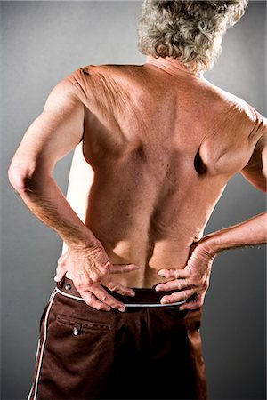 Rear view of senior man with arthritis back pain, studio shot Stock Photo - Rights-Managed, Code: 842-03200684