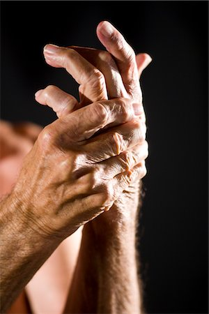 Close-up of senior man rubbing his sore hand Stock Photo - Rights-Managed, Code: 842-03200685