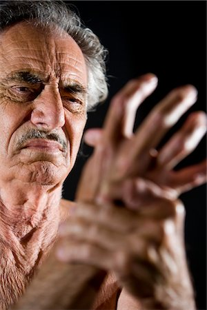 Close-up of senior man rubbing his sore hand Stock Photo - Rights-Managed, Code: 842-03200686
